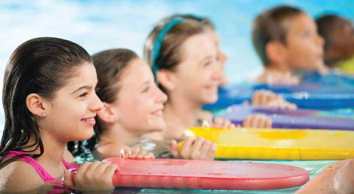 child swim lessons with flutter boards