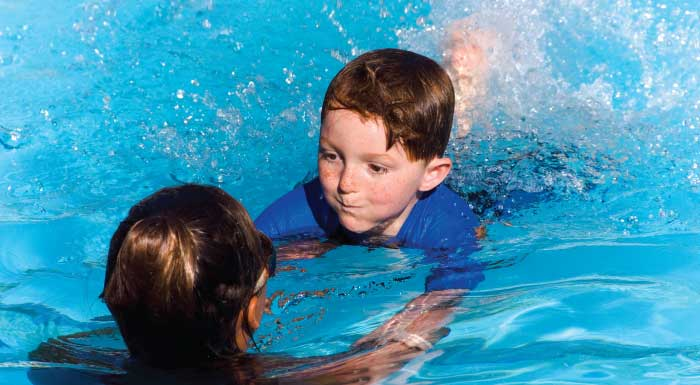 private lesson boy learning to swim one-on-one