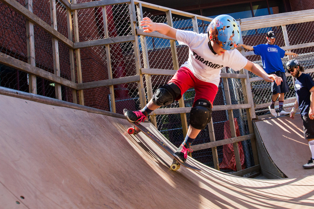 kid skateboarding on halfpipe ramp