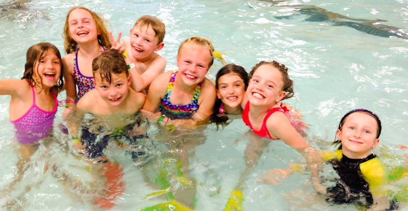 kids having fun in pool in recreational swim
