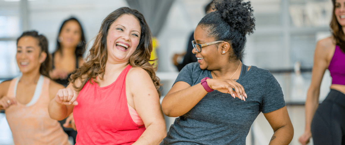 smiling women in a dance exercise class