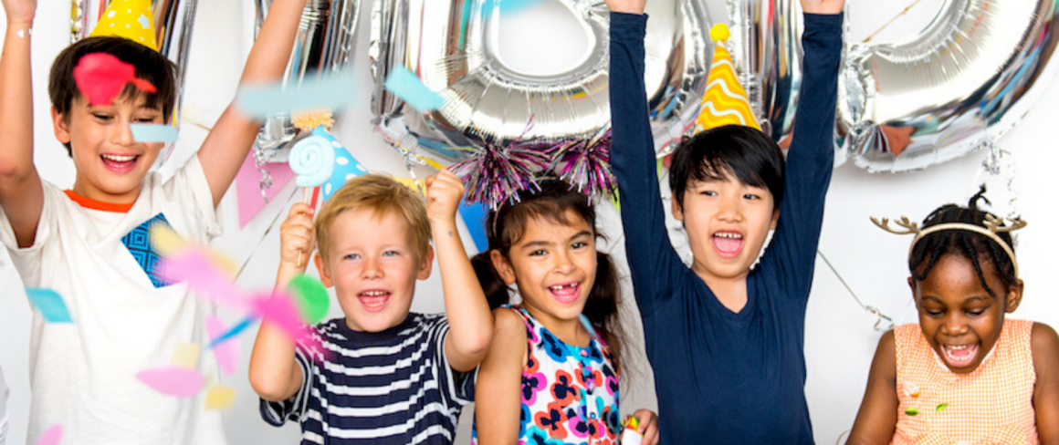 children smiling at a birthday party