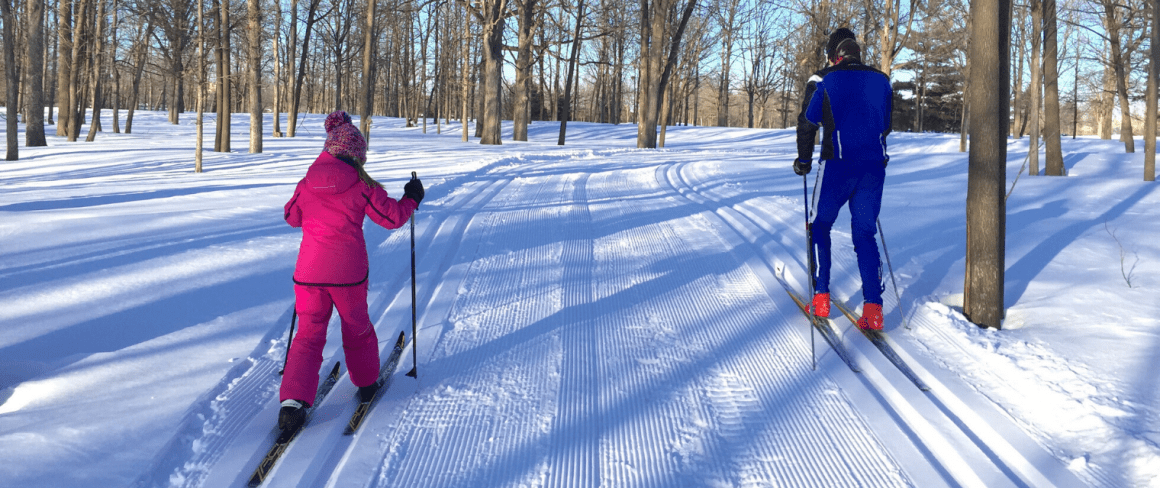 father and daughter out cross country skiing on the SJAM trail