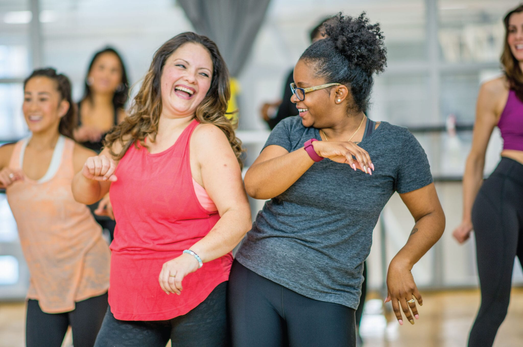 Women smiling in a fitness class