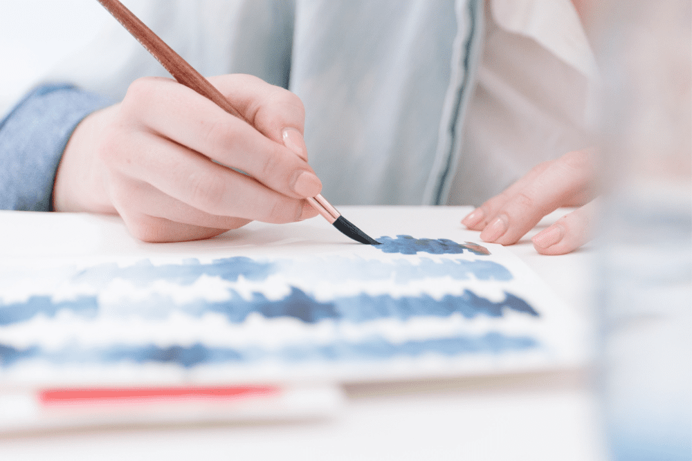 hand holding brush painting